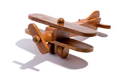 Retro wooden toy bi-plane. Retro rustic handcrafted wooden toy bi-plane with dual wings and a propeller reminiscent of a nostalgic childhood on a white Stock Photography