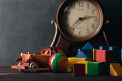 Retro wooden toy car with building blocks Stock Photo