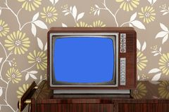 Retro wooden tv on wooden vitage 60s furniture Royalty Free Stock Photo