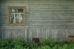 Retro wooden wall with window and flowers Royalty Free Stock Photos
