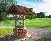Retro wooden well water Stock Photography