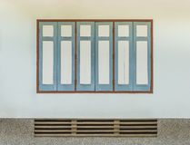 Retro wooden window on walls of the house with space Stock Photo