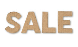 Retro word sale made of cardboard. On white background Royalty Free Stock Images