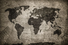Retro world map on concrete, plaster wall. Vintage, grunge background. Royalty Free Stock Photo