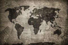Retro world map on concrete, plaster wall. Vintage, grunge background. Royalty Free Stock Photo