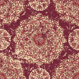 Retro worn carpet with ornaments. Royalty Free Stock Image