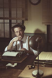 Retro writer looking for inspiration Stock Image
