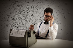 Retro writer. Man with glasses and pipe write with a typewriter Stock Photos