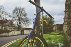 Retro yellow bike Stock Image