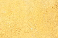 Retro yellow concrete wall background Stock Photos