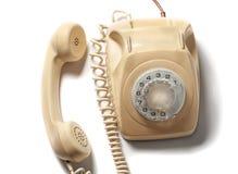 Retro yellow phone isolated on white background.  Royalty Free Stock Photo