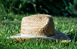 Retro yellow straw hat in the grass Stock Photos