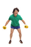 Retro young guy exercising with dumbbells Royalty Free Stock Photos