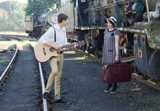 Retro young love couple vintage serenade train setting Stock Photography