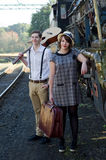 Retro young love couple vintage train setting Stock Image
