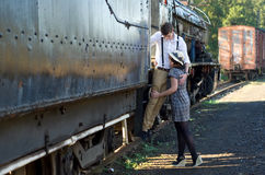 Retro young love couple vintage train setting Stock Photography