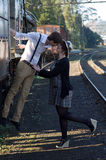 Retro young love couple vintage train setting Royalty Free Stock Photos