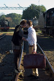 Retro young love couple vintage train setting Stock Photos