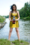 Retro young woman  with camera near the river Royalty Free Stock Photo
