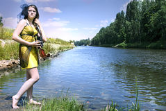Retro young woman  near the river Stock Images