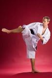 Retroceso con el pie de la correa negra del karate imágenes de archivo libres de regalías