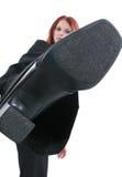 Retroceso con el pie de la mujer de negocios Imagen de archivo libre de regalías