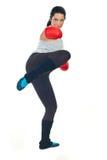 Retroceso con el pie de la mujer del boxeador Fotos de archivo
