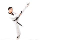 Retroceso con el pie del arte marcial del Taekwondo aislado Fotos de archivo libres de regalías