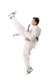 Retroceso con el pie del arte marcial del Taekwondo aislado Imagenes de archivo