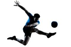 Retroceso con el pie del vuelo del futbolista del fútbol del hombre Imágenes de archivo libres de regalías