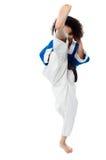 Retroceso de la muchacha del karate una pierna Imagen de archivo libre de regalías