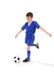 Retroceso del balón de fútbol con el pie Imágenes de archivo libres de regalías