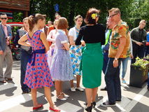 Retrofest in the park Sokolniki, Moscow.  The youth in the clothes of 1950-1960s. Retrofest in the park Sokolniki, Moscow. July, 2014. Young boys and girls Royalty Free Stock Images