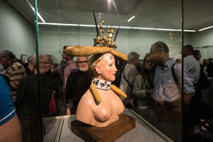 Retrospective Female Bust. Saint-Petersburg, Russia - October 28, 2016: Exhibition of works by Salvador Dali in the State Hermitage. Spectator consider sculpture royalty free stock image