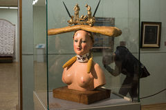 Retrospective Female Bust. Saint-Petersburg, Russia - October 28, 2016: Exhibition of works by Salvador Dali in the State Hermitage. Spectator consider sculpture stock photos