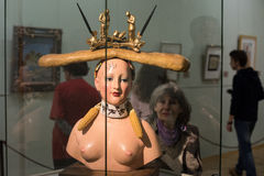 Retrospective Female Bust. Saint-Petersburg, Russia - October 28, 2016: Exhibition of works by Salvador Dali in the State Hermitage. Spectator consider sculpture royalty free stock photos