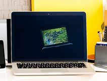 Retrospective of old iBook, MacBook Pro, PowerBook laptops Apple Royalty Free Stock Photo