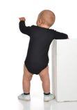 Retrovisione del caucasian un bambino infantile del bambino del neonato di anno stan immagine stock libera da diritti