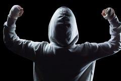Retrovisione del vincitore in cappuccio con le armi alzate Fotografia Stock Libera da Diritti