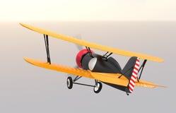Retrovisione del volo giallo e nero del biplano nel cielo Fotografie Stock Libere da Diritti
