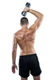 Retrovisione dell'atleta senza camicia che risolve con la testa di legno Immagine Stock Libera da Diritti