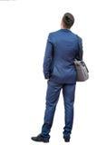 Retrovisione dell'uomo d'affari in vestito fotografia stock libera da diritti