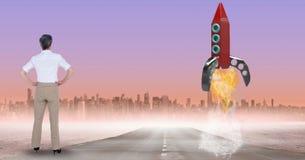 Retrovisione della donna di affari che esamina immagine composita digitale del programma del lancio del razzo fotografia stock libera da diritti