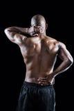Retrovisione di allungamento muscolare dell'atleta Immagine Stock
