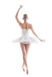 Retrovisione di giovane ballerina snella in tutu fotografie stock