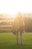 Retrovisione di luce solare diritta della ragazza Fotografia Stock Libera da Diritti