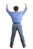Retrovisione di un uomo d'affari Raising i suoi pugni Fotografia Stock Libera da Diritti
