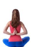 Retrovisione di yoga di pratica della donna esile Immagini Stock Libere da Diritti
