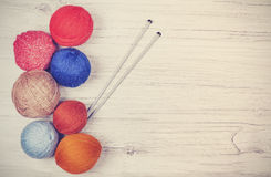 Retrto toned yarn balls on wooden boards. Royalty Free Stock Image