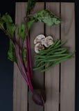 Rettiche, Pilze u. grüne Bohnen Stockbild
